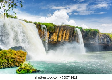 The Dray Nur Waterfall on the Serepok River at the Tay Nguyen (the Central Highlands) in Dak Lak Province (Daklak) of Vietnam. Summer landscape. The waterfall is a popular tourist destination of Asia.