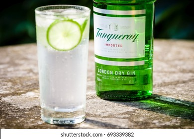 DRAZOVICE - JUNE 25: Bottle of Tanqueray gin and gin & tonic cocktail on June 25, 2016 in Drazovice, Czech Republic. Tanqueray is a brand of gin produced by Diageo plc.