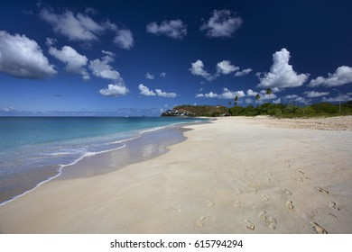 Dream beach in Antigua and Barbuda, Caribbean, on the beautiful sunny day with turquoise waters and perfect sand