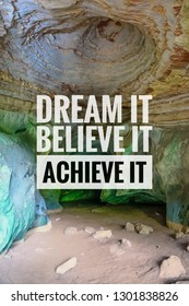 Dream it believe it achieve it . motivated quote on cave background