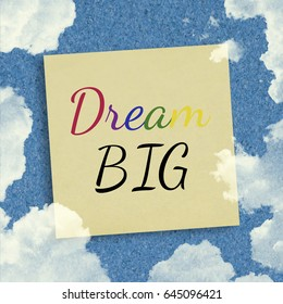 Dream Big inspirational quote on sky background