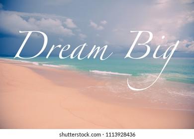 Dream big motivational quote over a seascape.