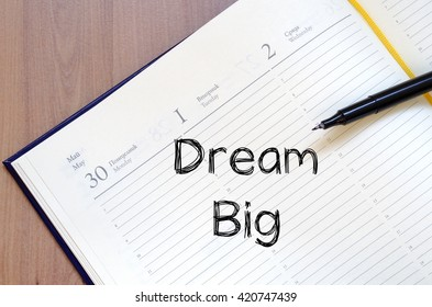 Dream big text concept write on notebook