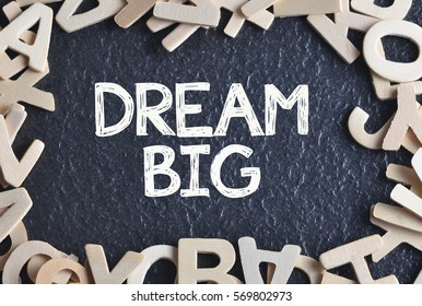 """""""Dream Big"""" written on copyspace with pile of wooden alphabet"""