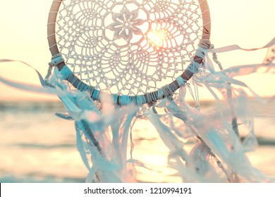 Dream catcher against sunrise. Handmade work is ethnic symbol.