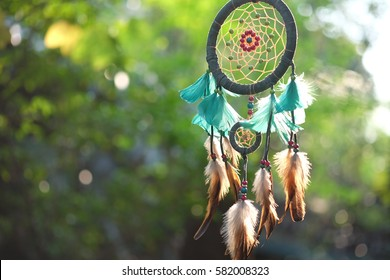 Dream Catcher Blue Coral with natural background in vintage style. boho chic, ethnic amulet.