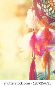 Dream catcher and colorful feather with blurred focus for background,  hope and dream concepts