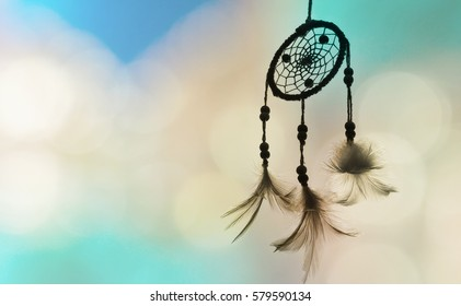 Dream catcher and light green color with blurred focus for background,
