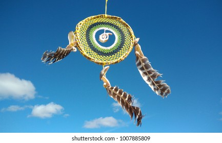 Dream catchers isolated over the blue sky