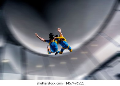 Dream fly. Man fly in wind tunnel. Indoor skydiving.