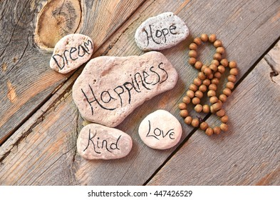 Dream, hope, happiness, kind and love written with meditation beads