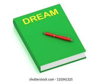 DREAM inscription on cover book and red pen on the book. 3D illustration isolated on white background