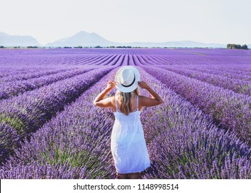 dream and inspiration, summer happy woman in romantic white dress enjoying nature in lavender flowers fields