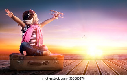Dream journey - Little Girl On Suitcase At Sunset