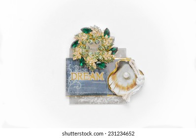 dream message on jewelry broach pin with green and white gemstones and seashell with pearl