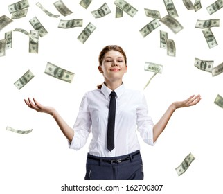 Dream of raining money / studio shoot of beautiful attractive business woman under money rain - isolated on white background