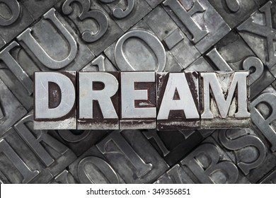 dream word concept made from metallic letterpress blocks on many letters background