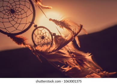 Dreamcatcher, the mountains and sunset. Boho chic, ethnic amulet,symbol of american ethnic Indians people.