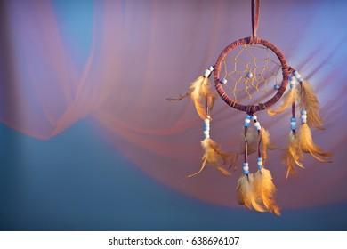 dreamcatcher on a color velvet background.concept dream