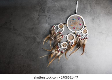 Dreamcatcher on Gray-black cement floor background with copy space.