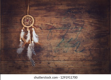 dreamcatcher on wooden board with space for text