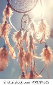 Dreamcatcher sunset, boho chic, ethnic amulet, symbol. toned image