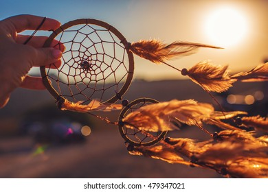 Dreamcatcher sunset , the mountains, boho chic, ethnic amulet,symbol. blurred background