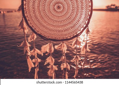 Dreamcatcher sunset , ocean background, boho chic, ethnic amulet,symbol.