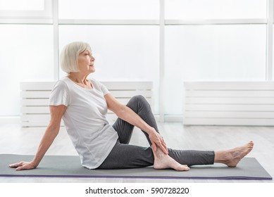 Dreamful mature lady resting after workout