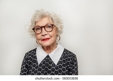 Dreamful old lady expressing positive emotions