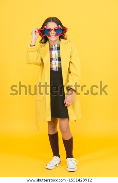 Dreaming about fame. Become popular. Celebrity child. Star concept. Fame and popularity. Cheerful girl wear eyeglasses. Cool kid celebrity. Popular schoolgirl. Carnival costume famous celebrity.