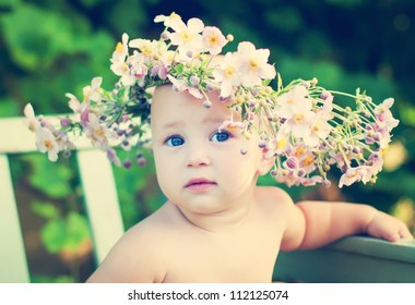dreaming girl in the big flower garland