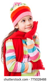 Dreaming girl in winter clothes looking sideways, isolated on white