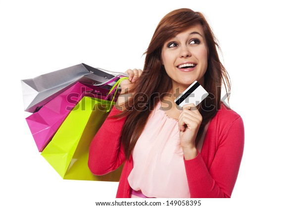 Dreaming woman with shopping bags and credit card