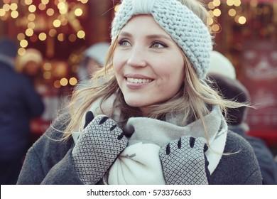 Dreaming woman in winter city a festive mood