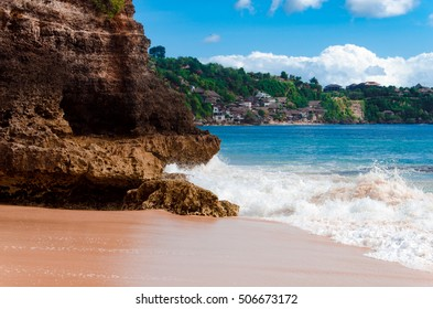 Dreamland beach (New Kuta Beach) in Bali, shore line with white stone cliff and high waves of the Indian Ocean. Surfers' paradise. Located on the Bukit peninsula, Indonesia.