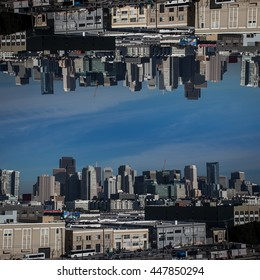 Dream-like San Francisco skyline inverted on top of itself, subdued tones