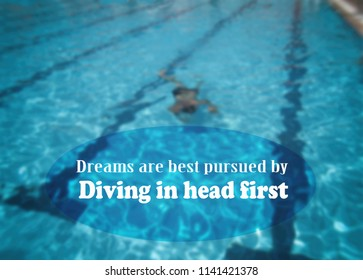Dreams are best pursued by diving in head first. Motivation, poster, quote, blurred image.