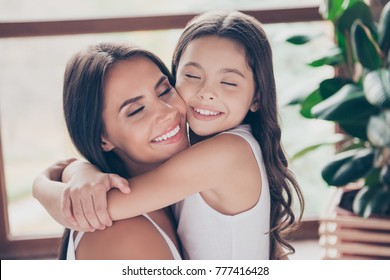 Dreams come true! My dear mummy is here and she'll never leave me alone! Close up photo of cute tender mother and her preteen daughter, they are hugging and were waiting for meeting for a long time