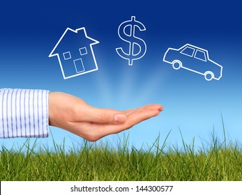 Dreams. House, dollar symbol and car in hand.