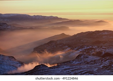 Dreamworld of orange mists at sunset in the Lake District