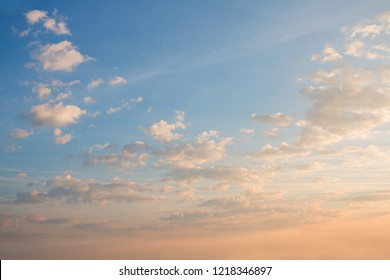 dreamy background with fluffy clouds at shiny morning. color gradient sky from yellow to blue