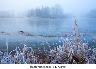 Dreamy frozen landscape. Like a fairytale view of frozen nature. Beautiful pond covered by ice in Lednice, south Moravia, Czech Republic.