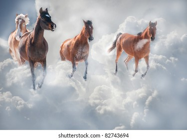 Dreamy image of horses running through storm clouds