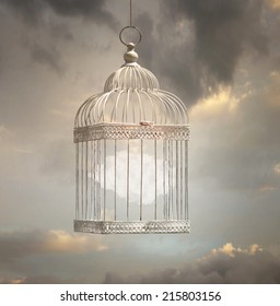 Dreamy image that represent a cloud inside a cage with a beautiful sky in the background