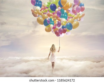 Dreamy image of a young blonde beauty walking in clouds