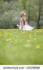Dreamy pretty woman in the park