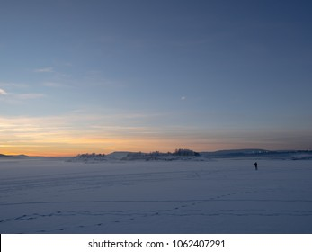 """Dreamy, scenic winter sea landscape at sunset, Oslofjorden is covered with ice and snow and allows people to """"walk on water"""""""