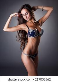 Dreamy slender woman posing in erotic lingerie