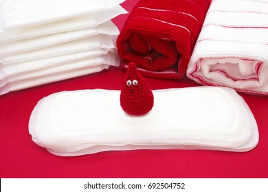 Dreamy smile crochet blood drop, Terry bath towels, daily and menstrual pads. Woman critical days, gynecological menstruation cycle. Hygiene conception photo. Menstruation sanitary woman hygiene